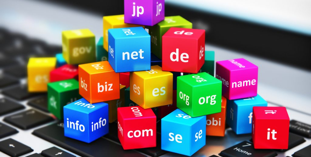 macro view of group of colored cubes with domain name extensions on a laptop keyboard